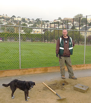 Jason repairing the sprinklers - Grover supervising