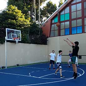 UNRC-exterior basketball court play
